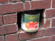 tomato tin in the wall, chopped tomatoes, street art, Is It Art?, Maryann Adair,