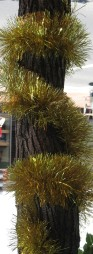Christmas Tinsel around a pole, Christmas decorations, street art, urban art, is it art?