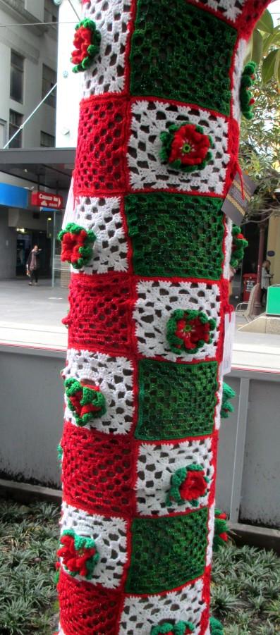 christmas sleever - guerilla knitting, yarn bombing, Christmas, is it art? street art,