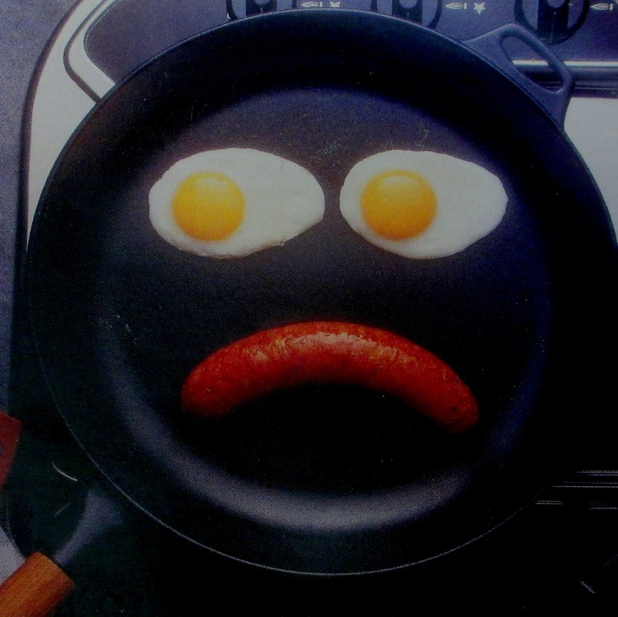unhappy face. Two eggs and a sausage if a fry pan, is it art?