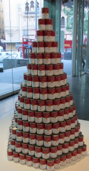 Tess Saunders - Consume (595 soup can pyramid depicting consume, crave, desire and want)